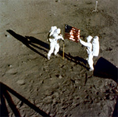 Astronauts Neil Armstrong and Edwin (Buzz) Aldrin bicker over who gets to plant the flag